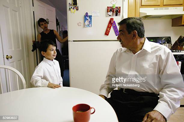 Joe Martinez tells Josiah his 5yearold son to finish dressing as his wife Jeanette looks on in their Staten Island home before heading to Sunday...