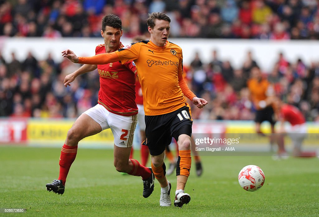 Joe Mason of Wolverhampton Wanderers and Eric Lichaj of Nottingham Forest during the Sky Bet Championship match between Nottingham Forest and Wolverhampton Wanderers on April 30, 2016 in Nottingham, United Kingdom.