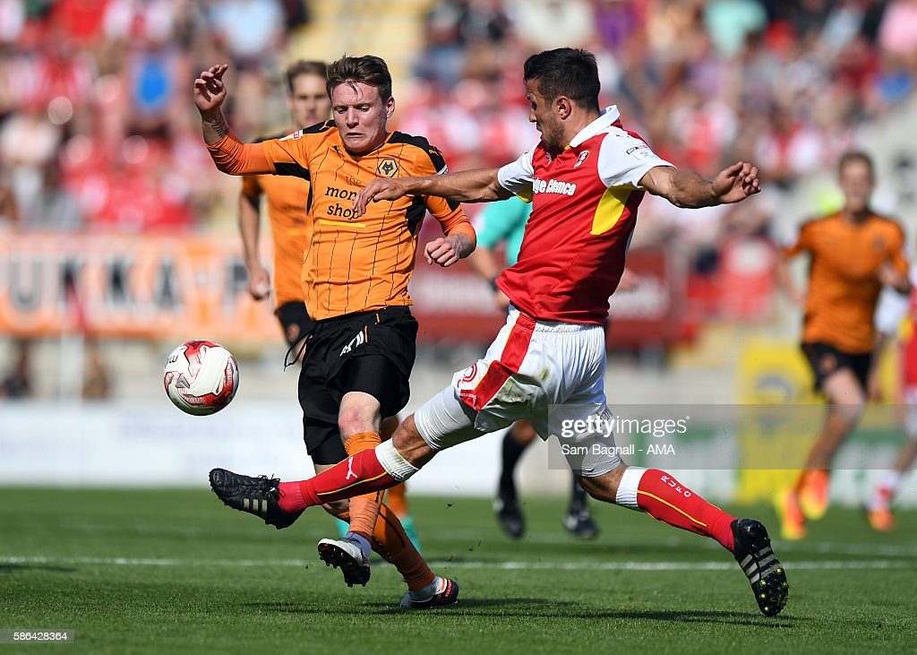 Joe Mason of Wolverhampton Wanderers and Richard Wood of Rotherham United during the Sky Bet Championship match between Rotherham United v Wolverhampton Wanderers at The New York Stadium on August 6, 2016 in Rotherham, England.