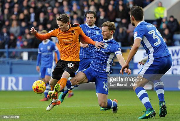 Joe Mason of Wolverhampton Wanderers and Tom Lees of Sheffield Wednesday during the Sky Bet Championship match between Sheffield Wednesday and...