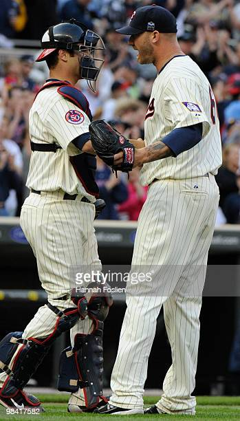 Joe Mauer and Jon Rauch of the Minnesota Twins celebrate a win after a game against the Boston Red Sox during the Twins home opener at Target Field...