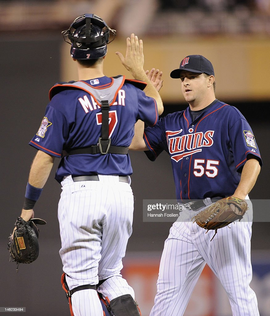 <a gi-track='captionPersonalityLinkClicked' href=/galleries/search?phrase=Joe+Mauer&family=editorial&specificpeople=214614 ng-click='$event.stopPropagation()'>Joe Mauer</a> #7 and <a gi-track='captionPersonalityLinkClicked' href=/galleries/search?phrase=Matt+Capps&family=editorial&specificpeople=536588 ng-click='$event.stopPropagation()'>Matt Capps</a> #55 of the Minnesota Twins celebrate a win against the Philadelphia Phillies on June 12, 2012 at Target Field in Minneapolis, Minnesota. The Twins defeated the Phillies 11-7.