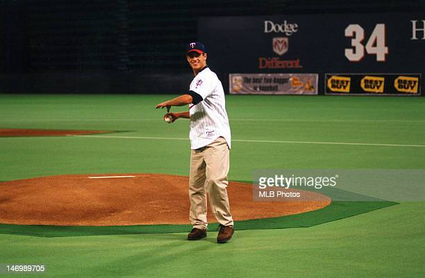 Joe Mauer first pick in the 2001 draft throws out the first pitch prior to the game between the Oakland Athletics and the Minnesota Twins at the...