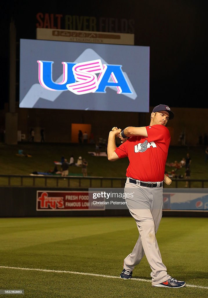 <a gi-track='captionPersonalityLinkClicked' href=/galleries/search?phrase=Joe+Mauer&family=editorial&specificpeople=214614 ng-click='$event.stopPropagation()'>Joe Mauer</a> #7 of Team USA warms up before the spring training game against the Colorado Rockies at Salt River Fields at Talking Stick on March 6, 2013 in Scottsdale, Arizona.