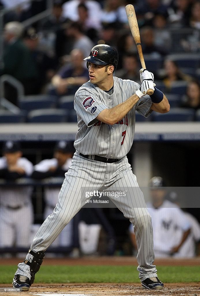 <a gi-track='captionPersonalityLinkClicked' href=/galleries/search?phrase=Joe+Mauer&family=editorial&specificpeople=214614 ng-click='$event.stopPropagation()'>Joe Mauer</a> #7 of the Minnesota Twins bats against the New York Yankees in Game Two of the ALDS during the 2009 MLB Playoffs at Yankee Stadium on October 9, 2009 in the Bronx borough of New York City.