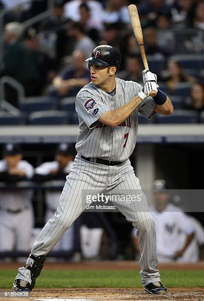 Joe Mauer of the Minnesota Twins bats against the New York Yankees in Game Two of the ALDS during the 2009 MLB Playoffs at Yankee Stadium on October...