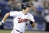 Joe Mauer of the Minnesota Twins bats against the Seattle Mariners on May 9 2009 at the Metrodome in Minneapolis Minnesota The Twins won 96