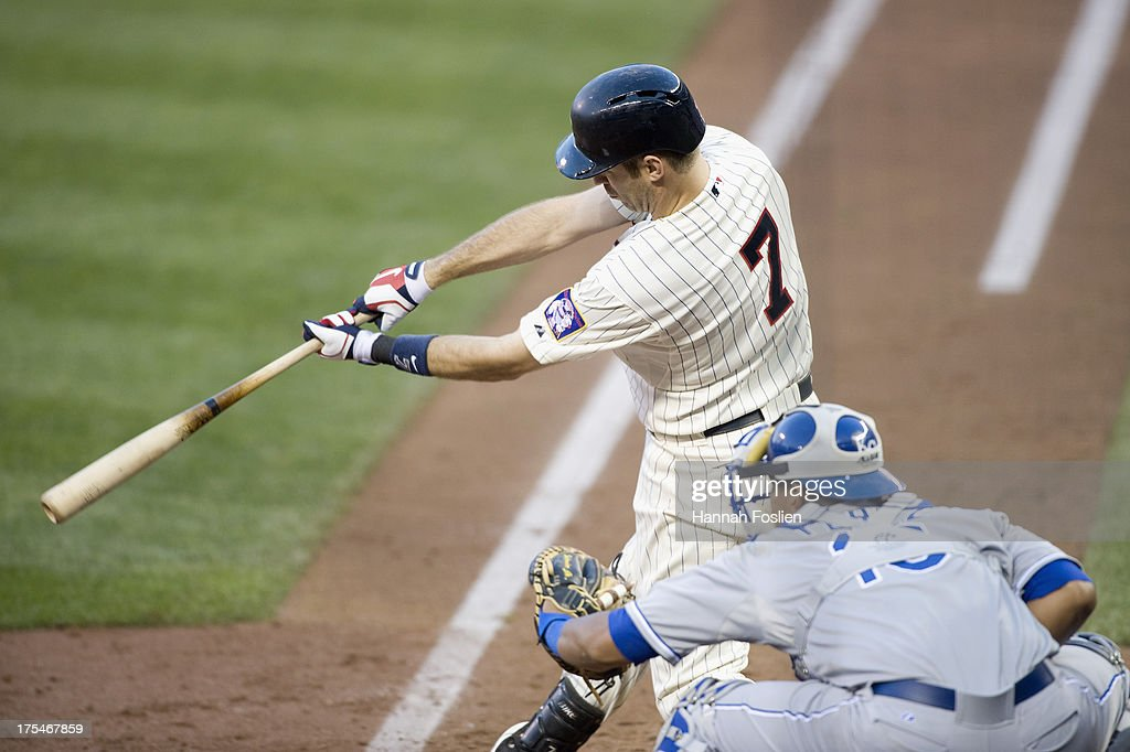 <a gi-track='captionPersonalityLinkClicked' href=/galleries/search?phrase=Joe+Mauer&family=editorial&specificpeople=214614 ng-click='$event.stopPropagation()'>Joe Mauer</a> #7 of the Minnesota Twins bats as Salvador Perez #13 of the Kansas City Royals catches on July 31, 2013 at Target Field in Minneapolis, Minnesota.