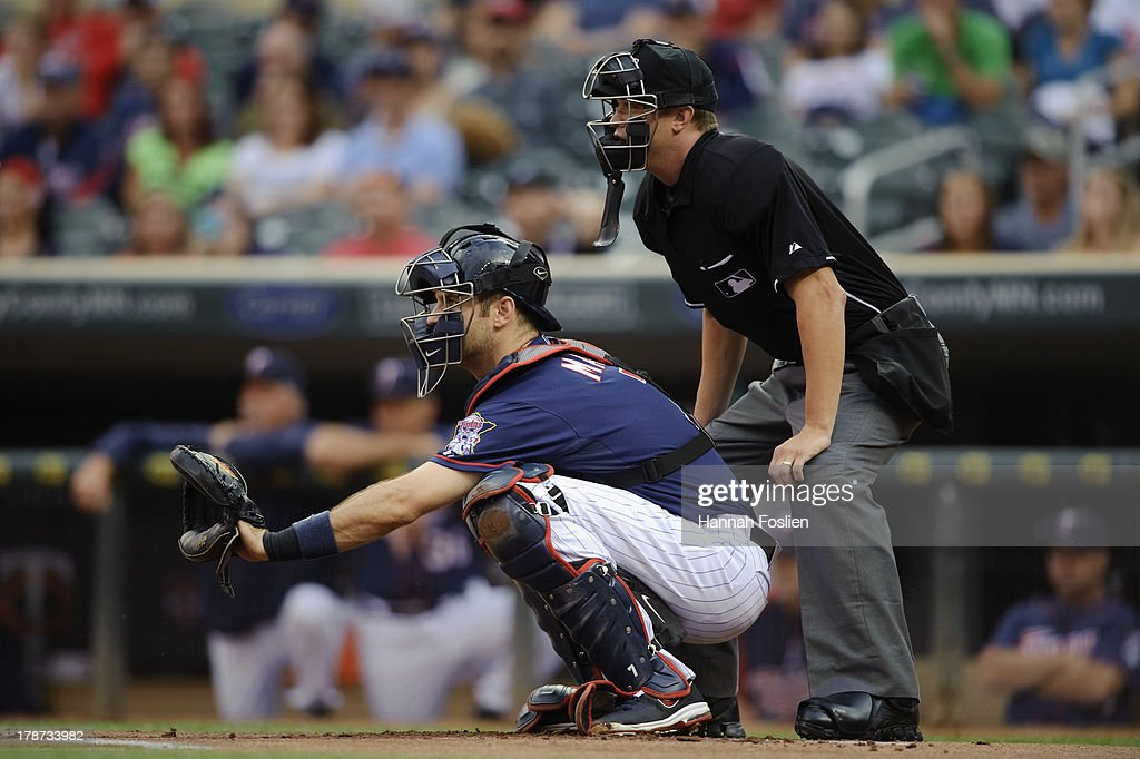 <a gi-track='captionPersonalityLinkClicked' href=/galleries/search?phrase=Joe+Mauer&family=editorial&specificpeople=214614 ng-click='$event.stopPropagation()'>Joe Mauer</a> #7 of the Minnesota Twins catches as home plate umpire Cory Blaser #89 calls balls and strikes during the game between the Minnesota Twins and the Chicago White Sox on August 15, 2013 at Target Field in Minneapolis, Minnesota.
