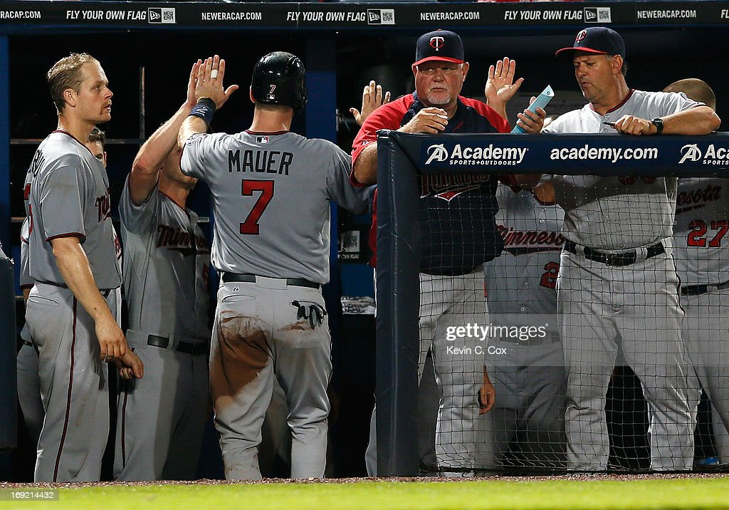 <a gi-track='captionPersonalityLinkClicked' href=/galleries/search?phrase=Joe+Mauer&family=editorial&specificpeople=214614 ng-click='$event.stopPropagation()'>Joe Mauer</a> #7 of the Minnesota Twins celebrates after scoring in the eighth inning against the Atlanta Braves at Turner Field on May 21, 2013 in Atlanta, Georgia.
