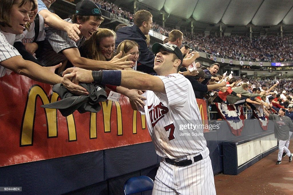 Joe Mauer #7 of the Minnesota Twins celebrates with fans after winning the American League tiebreaker game against the Detroit Tigers on October 6, 2009 at Hubert H. Humphrey Metrodome in Minneapolis, Minnesota.