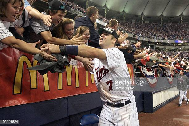 Joe Mauer of the Minnesota Twins celebrates with fans after winning the American League tiebreaker game against the Detroit Tigers on October 6 2009...