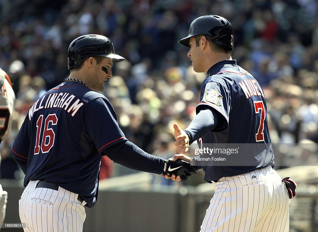 <a gi-track='captionPersonalityLinkClicked' href=/galleries/search?phrase=Joe+Mauer&family=editorial&specificpeople=214614 ng-click='$event.stopPropagation()'>Joe Mauer</a> #7 of the Minnesota Twins congratulates <a gi-track='captionPersonalityLinkClicked' href=/galleries/search?phrase=Josh+Willingham&family=editorial&specificpeople=537640 ng-click='$event.stopPropagation()'>Josh Willingham</a> #16 on a two run home run against the Detroit Tigers during the third inning of the game on April 4, 2013 at Target Field in Minneapolis, Minnesota.