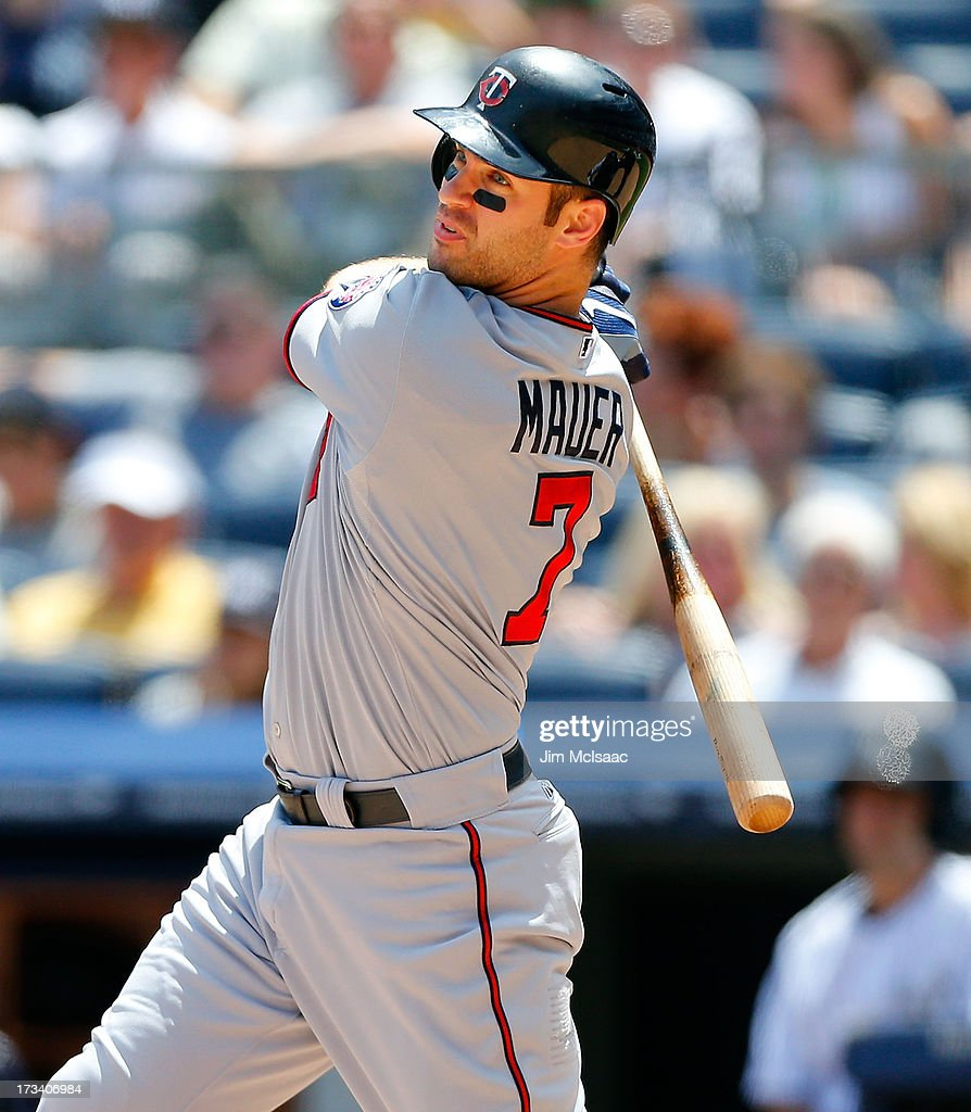 <a gi-track='captionPersonalityLinkClicked' href=/galleries/search?phrase=Joe+Mauer&family=editorial&specificpeople=214614 ng-click='$event.stopPropagation()'>Joe Mauer</a> #7 of the Minnesota Twins doubles in the fourth inning against the New York Yankees at Yankee Stadium on July 13, 2013 in the Bronx borough of New York City.