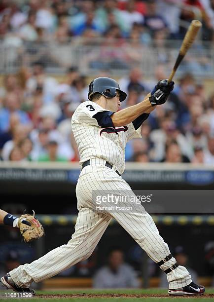 Joe Mauer of the Minnesota Twins gets an RBI single against the San Diego Padres in the first inning on June 17 2011 at Target Field in Minneapolis...
