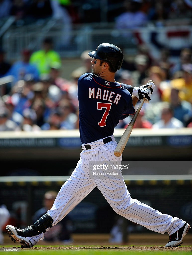 <a gi-track='captionPersonalityLinkClicked' href=/galleries/search?phrase=Joe+Mauer&family=editorial&specificpeople=214614 ng-click='$event.stopPropagation()'>Joe Mauer</a> #7 of the Minnesota Twins hits a three run home run against the Los Angeles Angels of Anaheim during the fifth inning on April 12, 2012 at Target Field in Minneapolis, Minnesota.