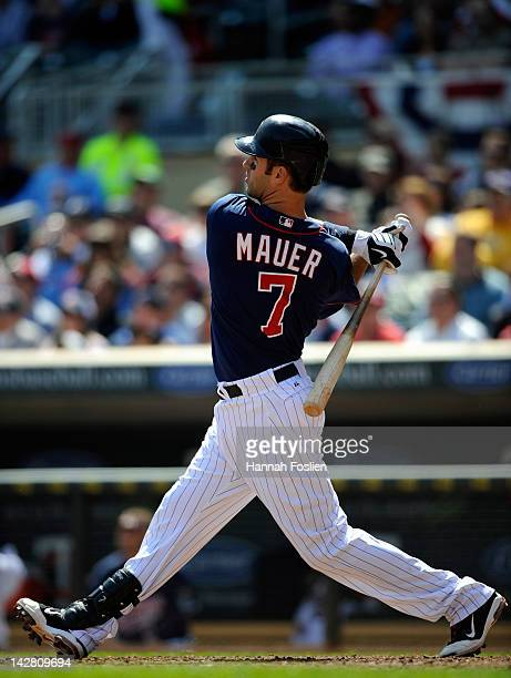 Joe Mauer of the Minnesota Twins hits a three run home run against the Los Angeles Angels of Anaheim during the fifth inning on April 12 2012 at...