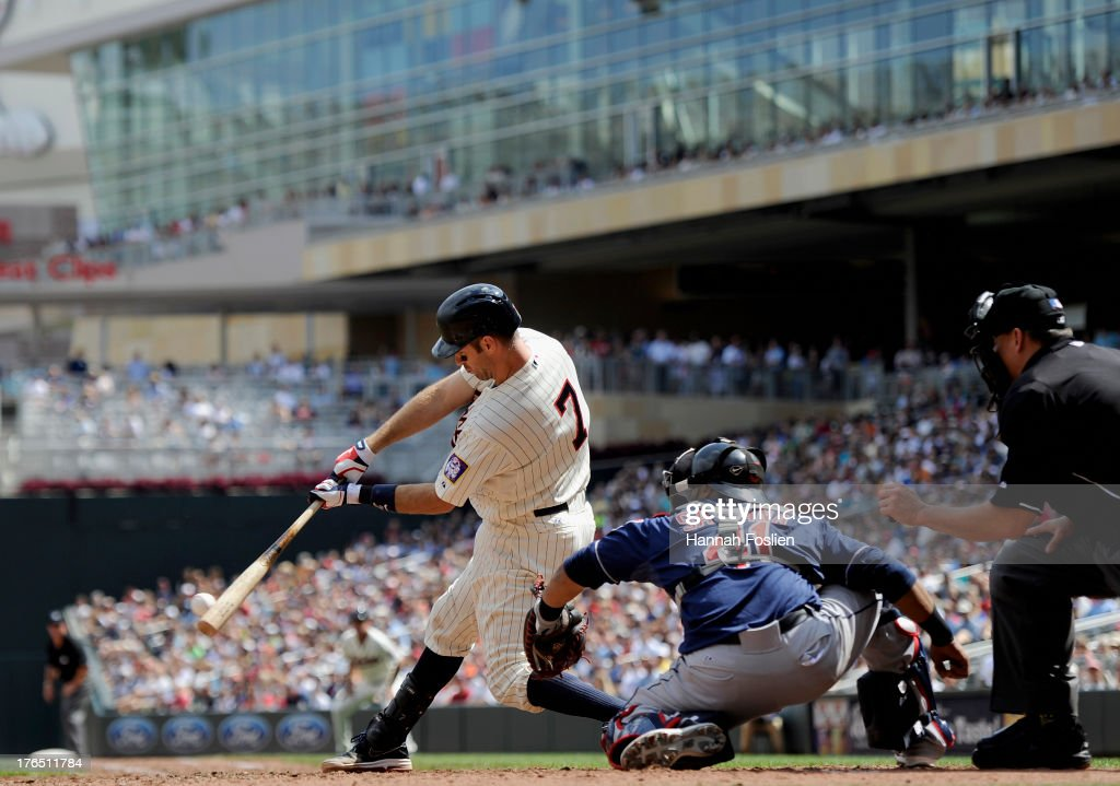 <a gi-track='captionPersonalityLinkClicked' href=/galleries/search?phrase=Joe+Mauer&family=editorial&specificpeople=214614 ng-click='$event.stopPropagation()'>Joe Mauer</a> #7 of the Minnesota Twins hits a two run single as Carlos Santana #41 of the Cleveland Indians catches during the seventh inning of the game on August 14, 2013 at Target Field in Minneapolis, Minnesota.