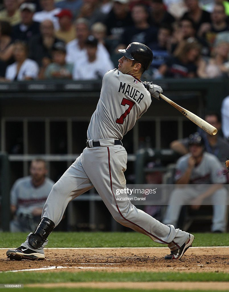 <a gi-track='captionPersonalityLinkClicked' href=/galleries/search?phrase=Joe+Mauer&family=editorial&specificpeople=214614 ng-click='$event.stopPropagation()'>Joe Mauer</a> #7 of the Minnesota Twins hits a two-run home run in the 2nd inning against the Chicago White Sox at U.S. Cellular Field on August 10, 2010 in Chicago, Illinois.