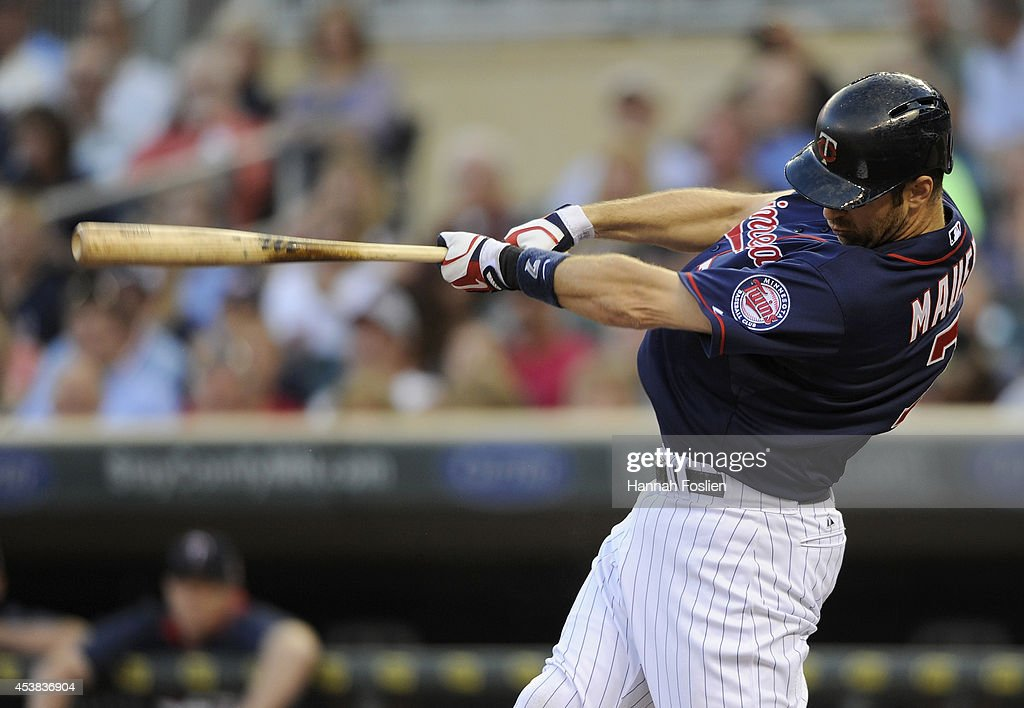 <a gi-track='captionPersonalityLinkClicked' href=/galleries/search?phrase=Joe+Mauer&family=editorial&specificpeople=214614 ng-click='$event.stopPropagation()'>Joe Mauer</a> #7 of the Minnesota Twins hits an RBI double against the Cleveland Indians during the first inning of the game on August 19, 2014 at Target Field in Minneapolis, Minnesota.
