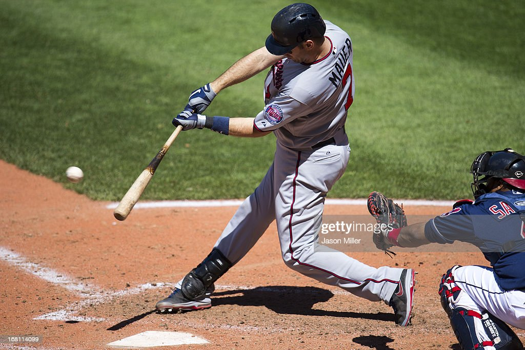 <a gi-track='captionPersonalityLinkClicked' href=/galleries/search?phrase=Joe+Mauer&family=editorial&specificpeople=214614 ng-click='$event.stopPropagation()'>Joe Mauer</a> #7 of the Minnesota Twins hits an RBI double during the seventh inning against the Cleveland Indians at Progressive Field on May 5, 2013 in Cleveland, Ohio. The Twins defeated the Indians 4-2.