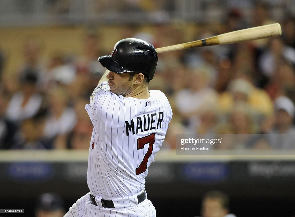 <a gi-track='captionPersonalityLinkClicked' href=/galleries/search?phrase=Joe+Mauer&family=editorial&specificpeople=214614 ng-click='$event.stopPropagation()'>Joe Mauer</a> #7 of the Minnesota Twins hits an RBI single against the Cleveland Indians during the eighth inning of the game on July 19, 2013 at Target Field in Minneapolis, Minnesota. The Twins defeated the Indians 3-2.