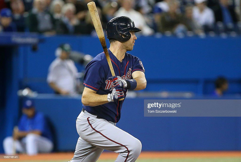 <a gi-track='captionPersonalityLinkClicked' href=/galleries/search?phrase=Joe+Mauer&family=editorial&specificpeople=214614 ng-click='$event.stopPropagation()'>Joe Mauer</a> #7 of the Minnesota Twins hits an RBI single in the fifth inning during MLB game action against the Toronto Blue Jays on October 1, 2012 at Rogers Centre in Toronto, Ontario, Canada.