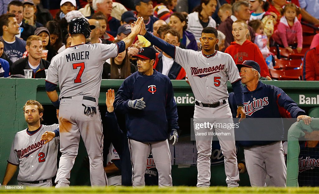 <a gi-track='captionPersonalityLinkClicked' href=/galleries/search?phrase=Joe+Mauer&family=editorial&specificpeople=214614 ng-click='$event.stopPropagation()'>Joe Mauer</a> #7 of the Minnesota Twins is congratulated by teammates in the dugout after scoring in the sixth inning against the Boston Red Sox during the game on May 9, 2013 at Fenway Park in Boston, Massachusetts.