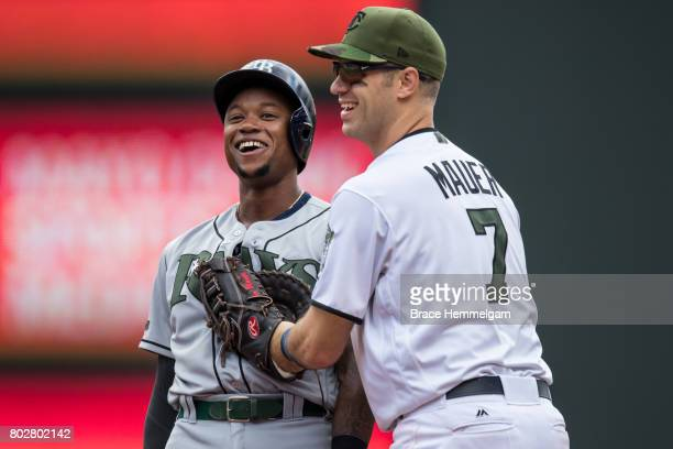 Joe Mauer of the Minnesota Twins laughs with Tim Beckham of the Tampa Bay Rays on May 28 2017 at Target Field in Minneapolis Minnesota The Rays...