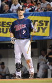 Joe Mauer of the Minnesota Twins leaves the dugout during an MLB game against the Pittsburgh Pirates at the Hubert H Humphrey Metrodome June 16 2009...
