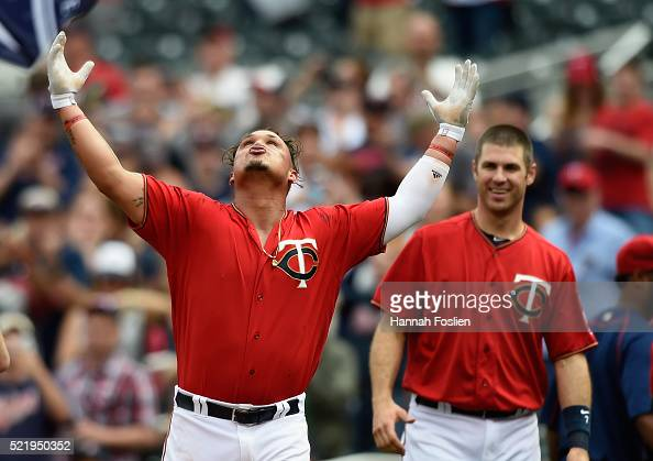 Joe Mauer of the Minnesota Twins looks on as teammate Oswaldo Arcia celebrates a walkoff single against the Los Angeles Angels of Anaheim during the...