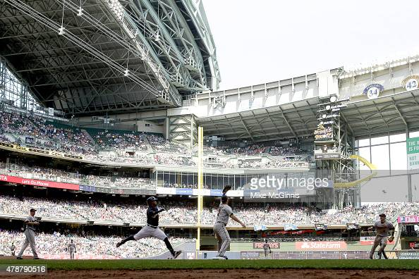 Joe Mauer of the Minnesota Twins makes the grab at first base to retire Jean Segura of the Milwaukee Brewers during the Interleague game at Miller...