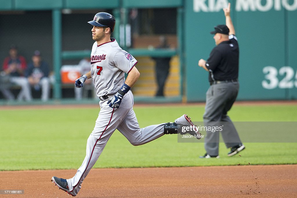<a gi-track='captionPersonalityLinkClicked' href=/galleries/search?phrase=Joe+Mauer&family=editorial&specificpeople=214614 ng-click='$event.stopPropagation()'>Joe Mauer</a> #7 of the Minnesota Twins rounds the bases after hitting a two run home run during the first inning against the Cleveland Indians at Progressive Field on June 22, 2013 in Cleveland, Ohio.