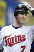 Joe Mauer of the Minnesota Twins smiles as he prepares to bat against the Kansas City Royals on August 13 2009 at the Metrodome in Minneapolis...