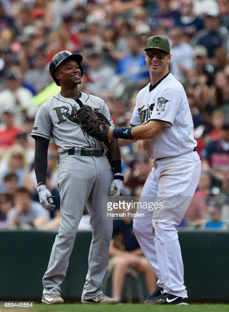 Joe Mauer of the Minnesota Twins tags out Tim Beckham of the Tampa Bay Rays at first base during the first inning of the game on May 28 2017 at...