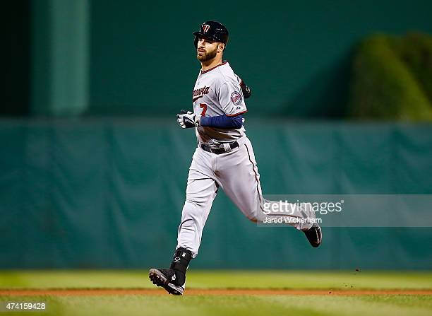 Joe Mauer of the Minnesota Twins trots around the bases after hitting the gamewinning solo home run in the 13th inning against the Pittsburgh Pirates...