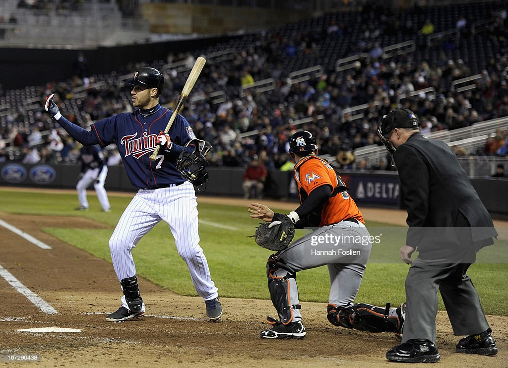 <a gi-track='captionPersonalityLinkClicked' href=/galleries/search?phrase=Joe+Mauer&family=editorial&specificpeople=214614 ng-click='$event.stopPropagation()'>Joe Mauer</a> #7 of the Minnesota Twins waves a runner home as Rob Brantly #19 of the Miami Marlins chases after a wild pitch during the third inning of the second game of a doubleheader on April 23, 2013 at Target Field in Minneapolis, Minnesota.