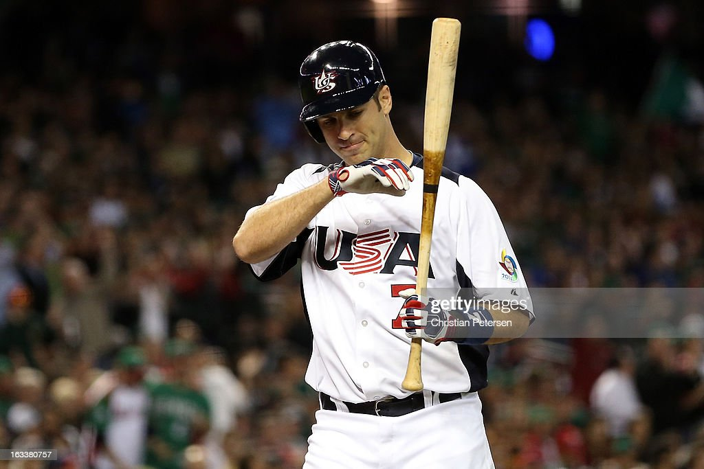 Joe Mauer #7 of the United States reacts after he struck out in the fourth inning against Mexico during the World Baseball Classic First Round Group D game at Chase Field on March 8, 2013 in Phoenix, Arizona.