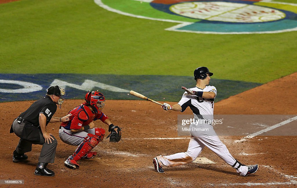 <a gi-track='captionPersonalityLinkClicked' href=/galleries/search?phrase=Joe+Mauer&family=editorial&specificpeople=214614 ng-click='$event.stopPropagation()'>Joe Mauer</a>#7 of the United States hits during a World Baseball Classic second round game against Puerto Rico at Marlins Park on March 12, 2013 in Miami, Florida.