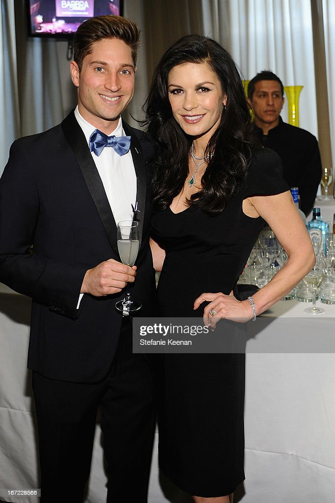 Joe McCanta, Brand Ambassador for Grey Goose and actress Catherine Zeta Jones pose at the Grey Goose cocktail reception of The Film Society of Lincoln Center's 40th Chaplin Award Gala at Avery Fisher Hall, Lincoln Center on April 22, 2013 in New York City.