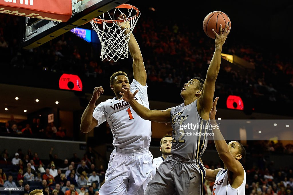 Joe McDonald #22 of the George Washington Colonials drives to the basket against Justin Anderson #1 of the Virginia Cavaliers in the first half during a game at John Paul Jones Arena on November 21, 2014 in Charlottesville, Virginia.