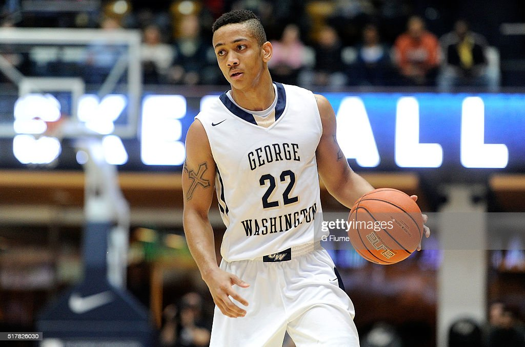 Joe McDonald of the George Washington Colonials handles the ball against the George Mason Patriots at the Charles E Smith Athletic Center on March 1...