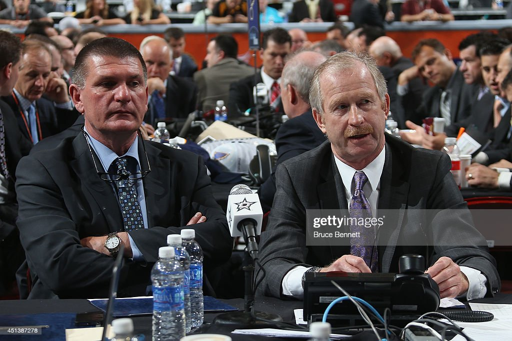 Joe McDonnell, scout of the Dallas Stars sits alongsdie <a gi-track='captionPersonalityLinkClicked' href=/galleries/search?phrase=Jim+Nill&family=editorial&specificpeople=2298874 ng-click='$event.stopPropagation()'>Jim Nill</a>, General Manager of the Dallas Stars, on Day Two of the 2014 NHL Draft at the Wells Fargo Center on June 28, 2014 in Philadelphia, Pennsylvania.