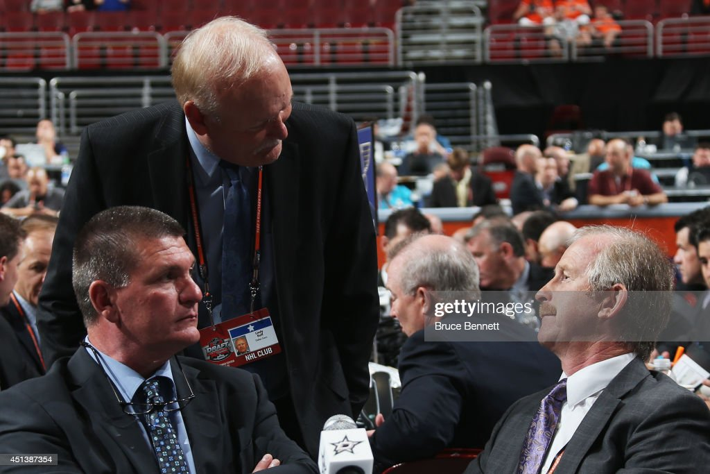 Joe McDonnell (L), scout of the Dallas Stars talks with <a gi-track='captionPersonalityLinkClicked' href=/galleries/search?phrase=Lindy+Ruff&family=editorial&specificpeople=243071 ng-click='$event.stopPropagation()'>Lindy Ruff</a> (C) of the Dallas Stars and <a gi-track='captionPersonalityLinkClicked' href=/galleries/search?phrase=Jim+Nill&family=editorial&specificpeople=2298874 ng-click='$event.stopPropagation()'>Jim Nill</a> (R), General Manager of the Dallas Stars, on Day Two of the 2014 NHL Draft at the Wells Fargo Center on June 28, 2014 in Philadelphia, Pennsylvania.