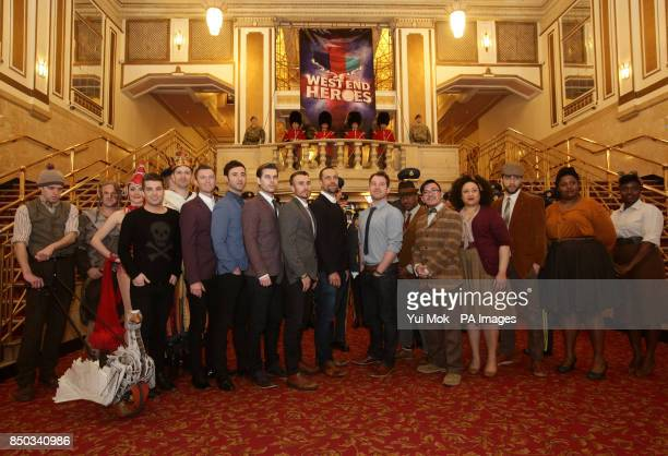 Joe McElderry with cast members from Spamalot Warhorse Some Like It Hip Hop and We Will Rock You are joined by members of the Central Band of the...