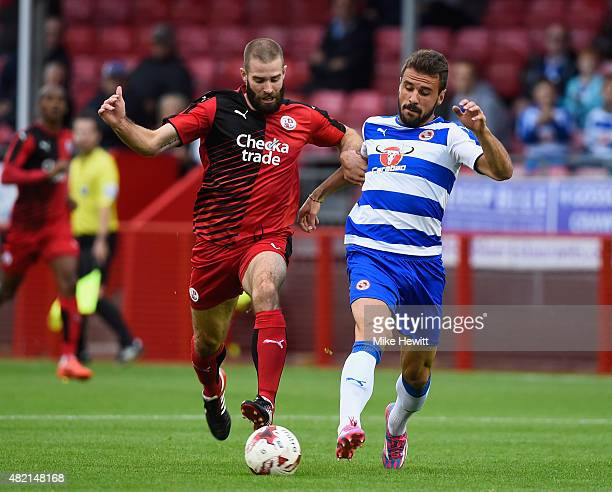 Joe McNerney of Crawley Town is challenged by Orlando Sa of Reading during a Pre Season Friendly between Crawley Town and Reading at Checkatradecom...