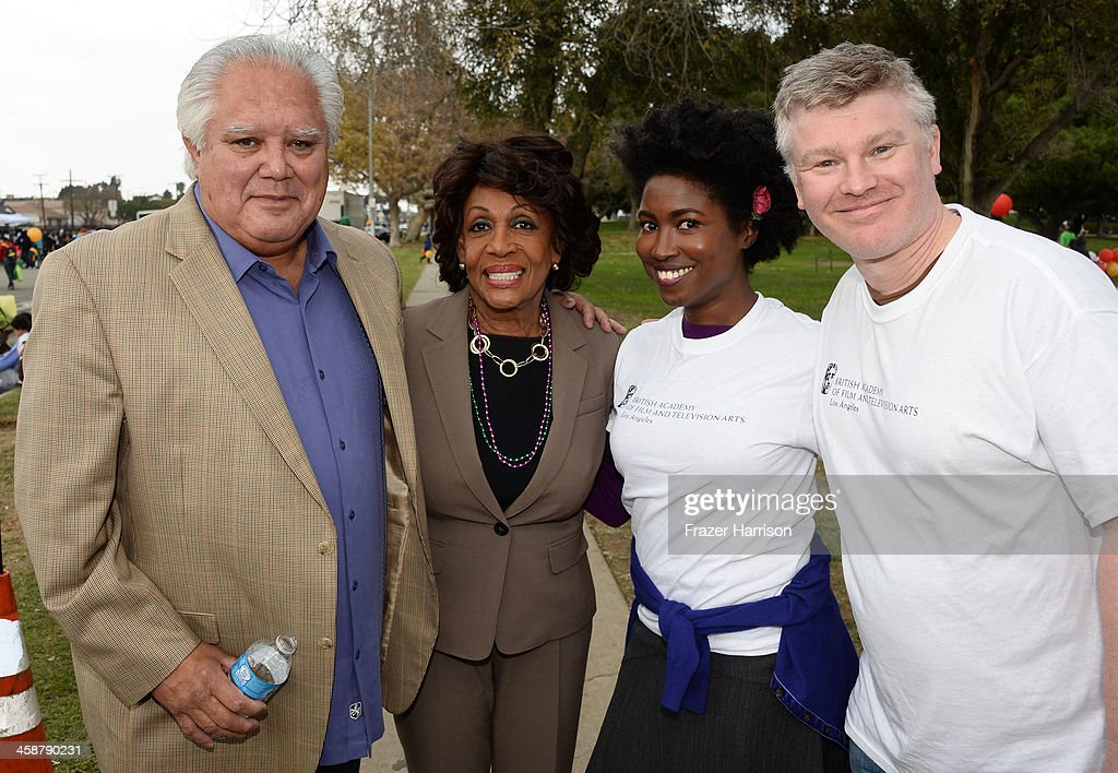 Joe Mendoza Los Angeles of the Department of Parks and Recreation, Congresswomen Maxine Waters, Kara Miller and Grahame Wood, BAFTA LA attend the BAFTA LA Inner City Christmas Party at Athens Park, on December 21, 2013 in Los Angeles, California.