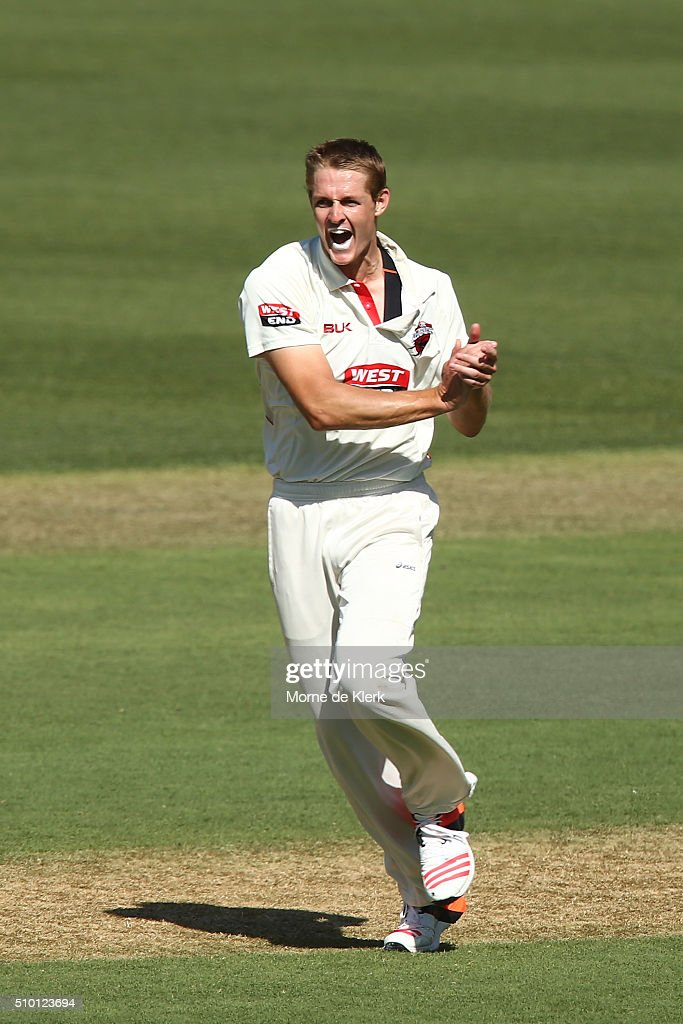 Joe Mennie of the Redbacks celebrates after getting the wicket of Peter Handscomb of the VIC Bushrangers during day one of the Sheffield Shield match between South Australia and Victoria at Adelaide Oval on February 14, 2016 in Adelaide, Australia.