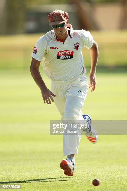 Joe Mennie of the Redbacks fields during the Sheffield Shield final between Victoria and South Australia on March 29 2017 in Alice Springs Australia