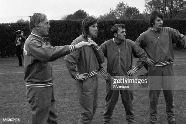 Joe Mercer England's caretaker manager left confers with forward Stan Bowles Les Cocker assistant trainer second right and midfielder Martin Peters...